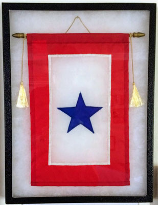 Families would hang a Service Flag in the window with a star for each family member serving their country during World War Two.