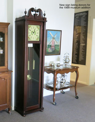 The grandfather clock (c. 1944) and tea cart (c. 1950s) were made by Colonial Manufacturing Company