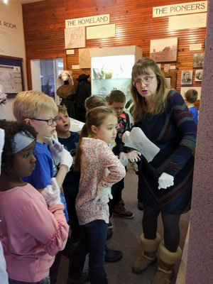 Children ask about displays in the Pioneer Room.