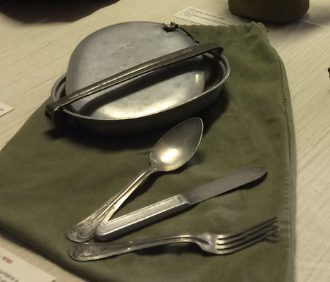 Metal mess kit contains a spoon, knife and fork. All stamped with U.S. on one side and 338 S 40 on the other.    c. 1917