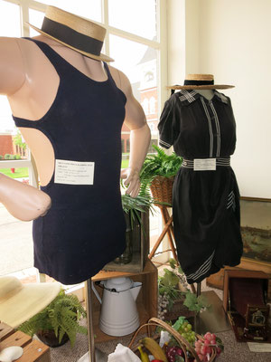 The 1920s lady's bathing suit features a blouse and attached bloomers with button-down skirt