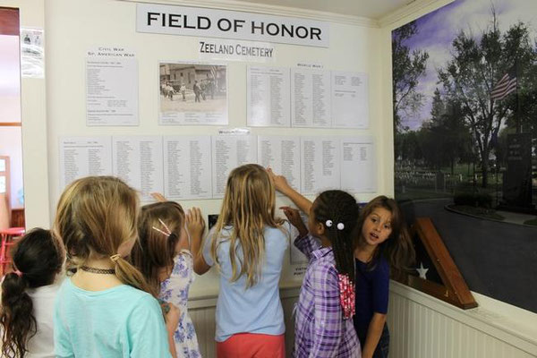 Second-graders eagerly look for their last names and other familiar names. Erin Dietzer/Sentinel Staff