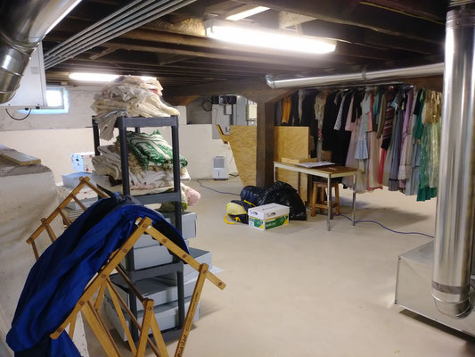 Scene of the schoolhouse storage area, which will become the work area for sorting, cleaning, documenting and properly storing valuable textiles.