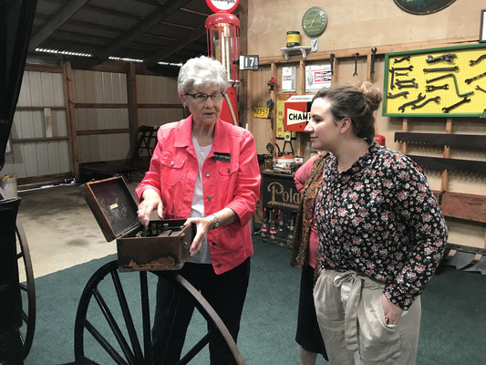 Jan Hoffman shows Audrey and Mary C a medical kit from the doctor's buggy of Dr. Roon who practiced medicine in the Forest Grove area. (photo by Susan)