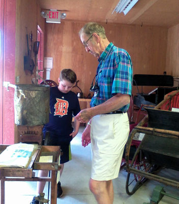 Robert, museum volunteer and voice of the Witness Tree, discusses artifacts with his grand nephew   [photo by Arlene]