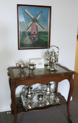 Moving on ... The seven-piece coffee / tea serving set, used by Randall and Cathy Dekker (c. 1940), stands beneath an original painting (artist and date unknown)