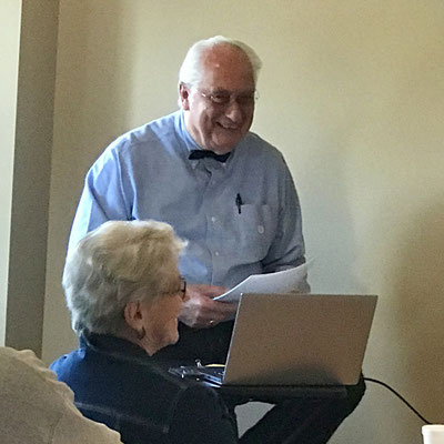 Jack VanEden and Mary Smith recall a story told by a member of the audience.