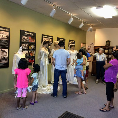 Docent Mary Lubbers describes the wedding dresses in the main gallery ::photo by Susan