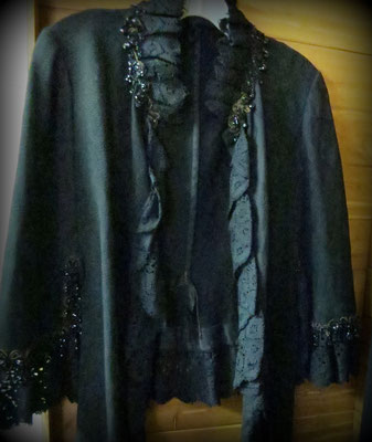 This beautiful lady's cape is handmade with black beads and crocheted lace trim.  c. 1900.