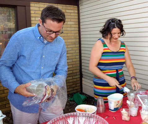 Board member, Justin Roebuck, works the table with his wife ::photo by Arlene
