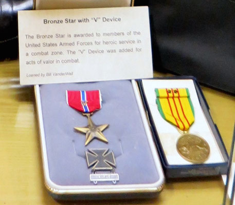 "The Bronze Star is awarded for heroic service in a combat zone with ""V"" Device for valor in combat.  Yellow medal is for serving during Vietnam.   On Loan from Bill VanderWall"