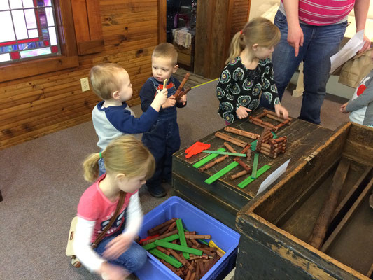 Children build log cabins in the Pioneer Room ::photo by Susan Norder