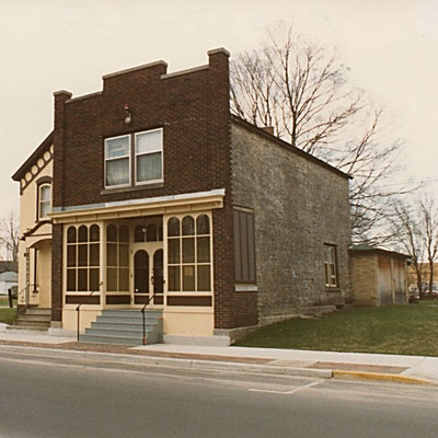 1987 - By 1987 the store front had been restored. Notice the empty space for the new addition.