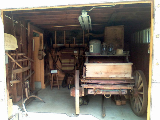 The open doors of the DeKruif Carriage House display a wagon manufactured by Wickers, DeKruif & Company - late 1800s   [photo by Arlene]
