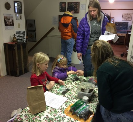 Planting bean seeds in the Veterans' Memorial Room ::photo by Susan Norder