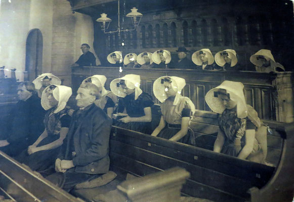 The 19th century photograph shows worshippers in the Dutch Reformed Church - Goes, The Netherlands.