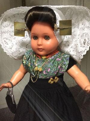 One of three dolls wearing Zeeland Dutch dress