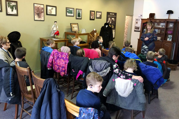 Miss Debbie welcomes the second-graders to the Zeeland Historical Museum.
