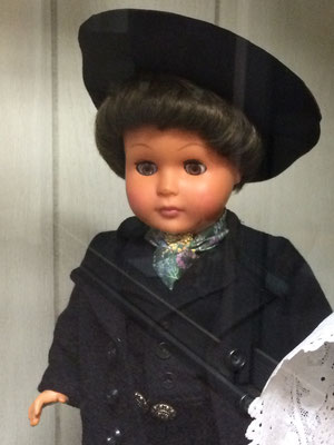 The three dolls are dressed in Protestant Sunday clothing