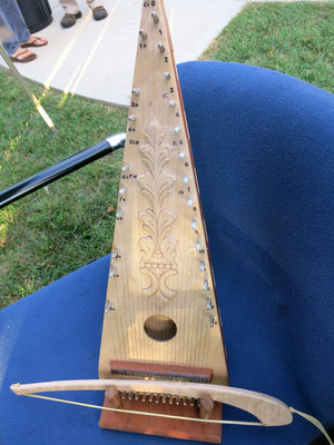 The fifth instrument in the band is called a Bowed Psaltery