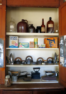 This storage cupboard was in the original Dekker Huis kitchen. It holds a collection of irons including those that were heated on the stove, those that were kerosene-fueled, and the more modern electric models