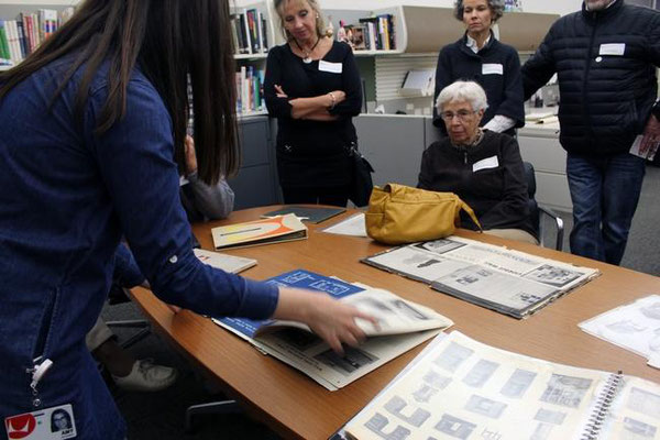 Herman Miller archivist Amy Auscherman, left, shows off some of the old furniture catalogs to attendants on Thursday, Nov. 12. Erin Dietzer/Sentinel Staff