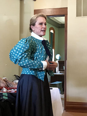 After adding corset covers, petticoats, and padding here and there, Wendy slipped a floor-length skirt over her head and fastened her multi-buttoned blouse.