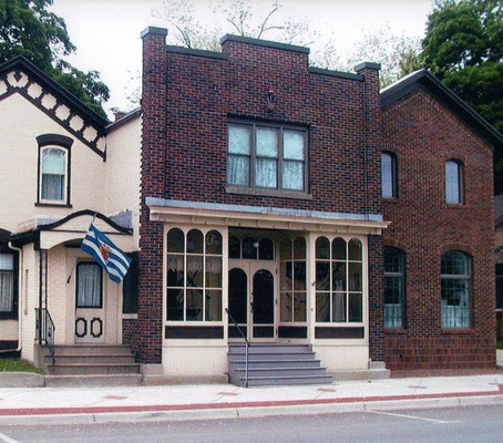 2004 - The new addition was completed in 1997.  Notice the upper floor windows on the store front.