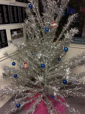 Our lighted aluminum Christmas tree is located in the Veterans Memorial Room on the 2nd floor