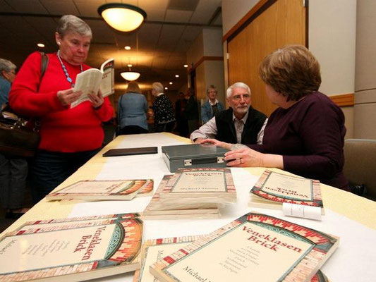 Copies of Michael Douma's book were available for sale following his presentation about Veneklasen bricks. Rob Wetterholt Jr./Sentinel Staff