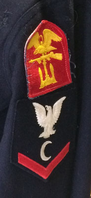 The patch with the red background, gold eagle and gun represents the special Amphibious Engineer Unit from D-Day.   The patch with the black background indicates that Dennis Wyngarden was a Ship's Cook (C) Third Class.