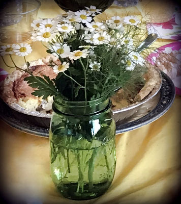 Green Ball canning jars were used as vases and behind the flowers, you can see one of the many homemade sausage and cheese quiche