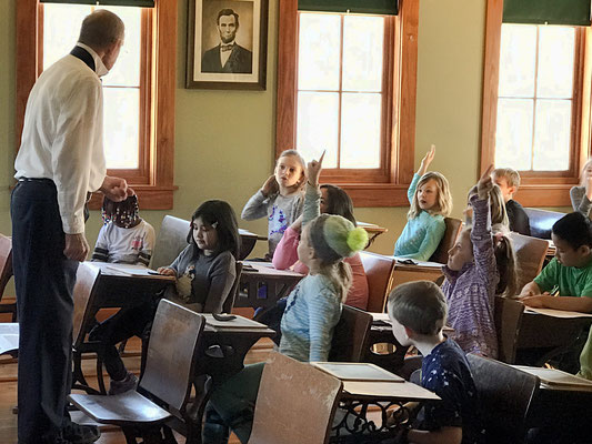 In one or two-room schoolhouses, students would raise one finger to answer a question.