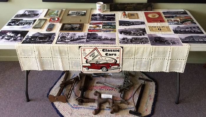 Displaying  vintage photographs of local vehicles, advertising items and automotive artifacts