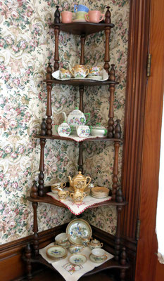 "Sometimes called a ""What-Not"" shelf, this five-tier walnut piece was hand made by J. H. Boone - you can tell the spires are not ""factory made"". Local dentist, Dr. Kuit and his wife Maybelle Coburn Kuit displayed this piece in their home at 34 East Central"