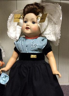 This doll is wearing an authentic dress worn in the city of Krabbendijke, Zeeland - c. 1960