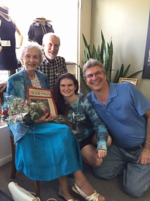 Dorothy poses with sons and granddaughter -- roses, courtesy of Don's Flowers and Gifts   [photo by Thom]