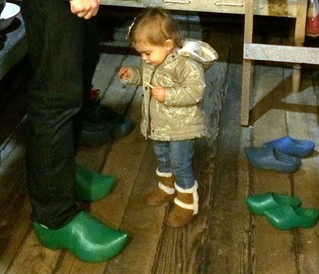 Dad tries on wooden shoes