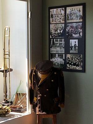 Zeeland High School band uniform and poster, which shows bands from the past
