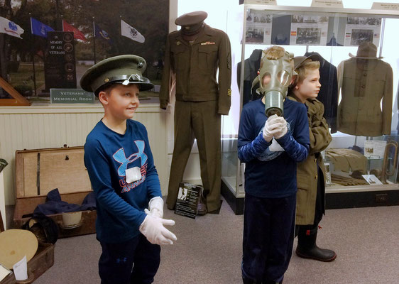 Trying on items in the Veterans' Memorial Room