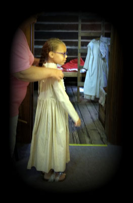 Dressing as a pioneer girl in the Pioneer Room  (photo by Debbie)