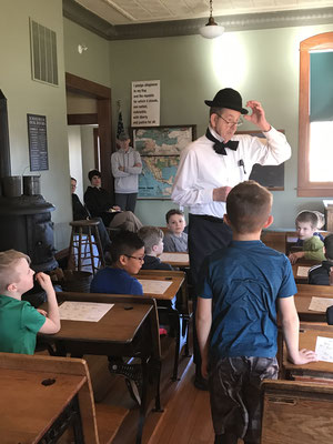 If a student met the schoolmaster or minister on the street, a young girl would curtsy and a boy would remove his hat as a greeting and a sign of respect.