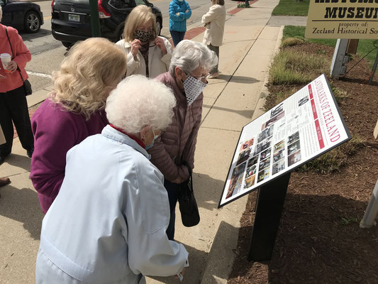 Members of the Zeeland Historical Society check out the new sign.   (photo by Susan Norder)