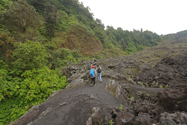 Walking on the edge of the lava flow from the last eruption in 2014.