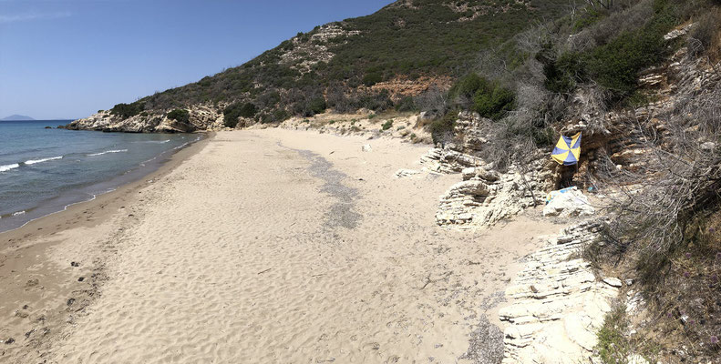 My own private beach including makeshift shelter from the burning sun.