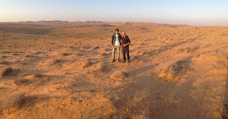Aviad and me posing amidst the stunning sanddunes.