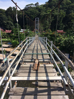 The Bohorok river flows through Bukit Lawang, both sides of town are connected by a series of rickety looking bridges.