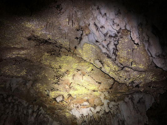 Golden dust on the ceiling of the cave.