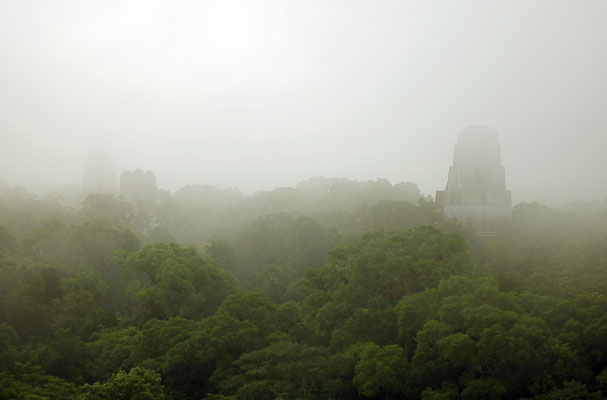 Temples piercing through the mist.