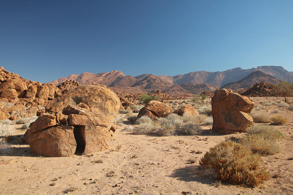 Stunning views with big boulders and distant mountains.